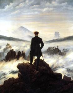 19-punti-di-vista-uomo-su-roccia-guarda-panorama-cime-montane