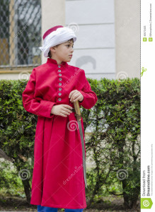 http://www.dreamstime.com/royalty-free-stock-photo-boy-janissary-side-profile-dressed-as-ottoman-red-tunic-turban-may-bucharest-image40673425